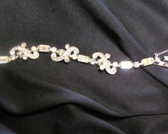 Vintage EISENBERG baguettes and winding pave ribbons of sparkling rhinestones..dimensional..bracelet