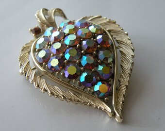 20% off LISNER leaf brooch, pin. Pink AB rhinestones. Gold tone metal.