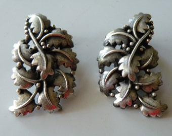 20% off TORTOLANI Leaf clip - on earrings. Silver plated.