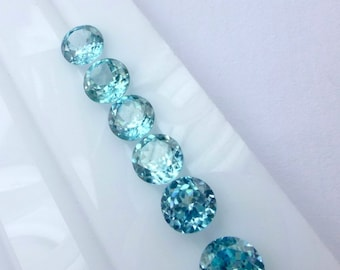 ZIRCON. Blue. Micro Facet.  Bright and Warm medium Blue. Rounds. Great For Studs. 1 pc. 1.45 cts. 6.5mm  (ZIR124)