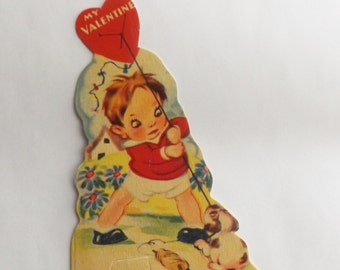 Vintage Valentine card die cut little boy playing tug of war with puppy dog over kite