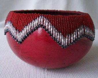 Small red gourd bowl, glass beads sewn at rim. 1342.