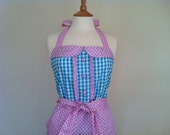 Retro apron with collar, blue and green gingham with blue dots on a pink fabric, fully lined.