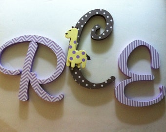 Wooden  letters for nursery spelling out your child's name coordinate with Pottery Barn Kids Ava Mod Giraffe bedding  l