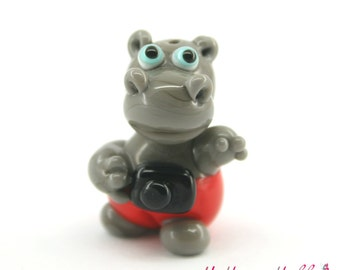 Glass lampwork hippopotamus (hippo) bead with camera photo