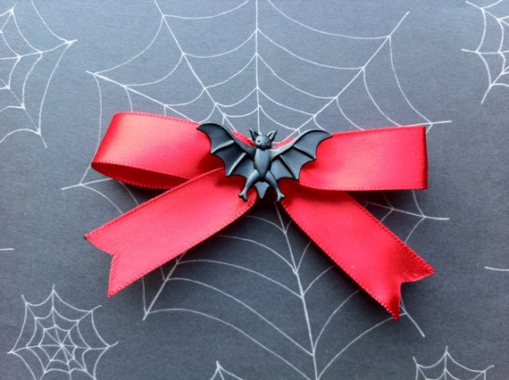 Creepy couture red hair bow with bat.