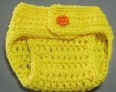 newborn size diaper cover in bright yellow