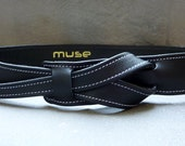 Black buckle-less leather belt  by Muse