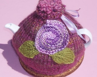 Floral teapot cosy Hand knitted in  burgendy yarn with purple roses and green leaves