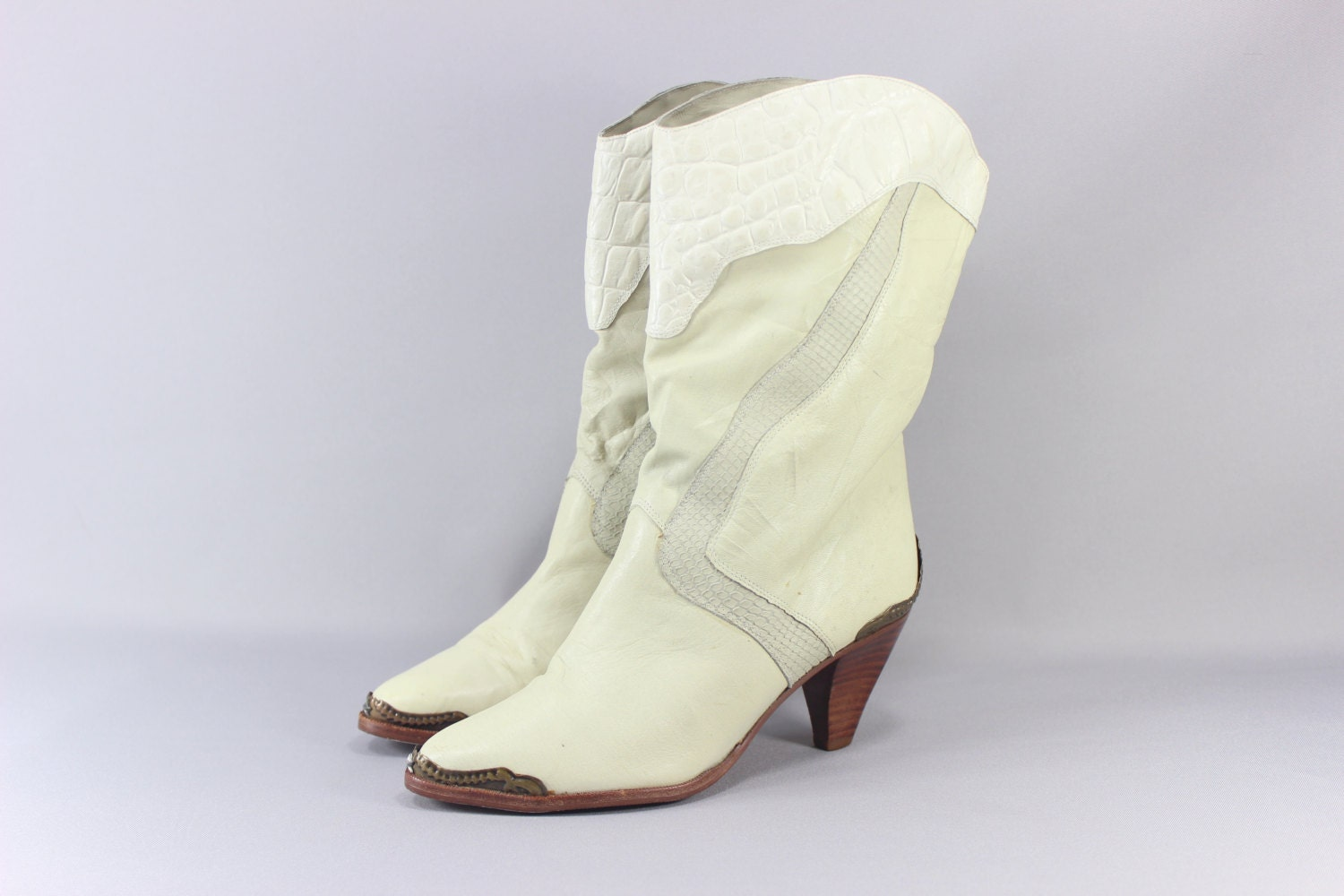 reserved sale ivory leather boots metal by southwestvintage
