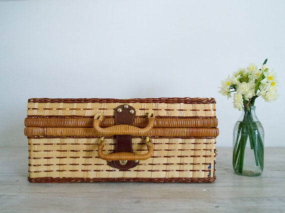vintage wicker picnic basket with blue and white checked interior