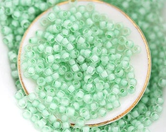 Seed beads, Toho size 11/0, Inside color Crystal - Neon Sea Foam Lined, N 975, rocailles, glass beads - 10g - S222