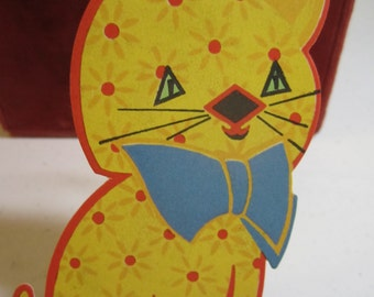Art Deco die cut 1930's bridge tally card bright yellow cat  decorated with red flowers and big blue bow