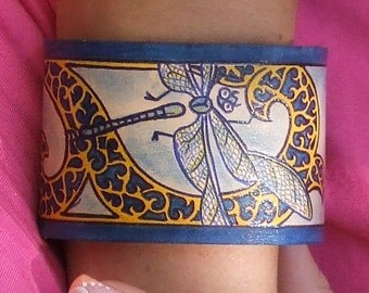 Leather bracelet. Hand painted dragonfly, 2 inches wide.