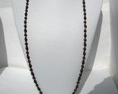 Strung Black Square Hematite, Gold Round, and Brown Textured Beads with a gold S hook