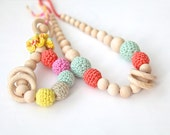 Pastel colors set of 2. Teething ring toy and nursing necklace. Light mint, coral, yellow rattle for baby and mom.