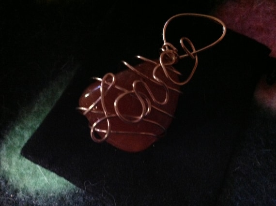 Carnelian stone wrapped in copper wire Reiki Charged Pendant