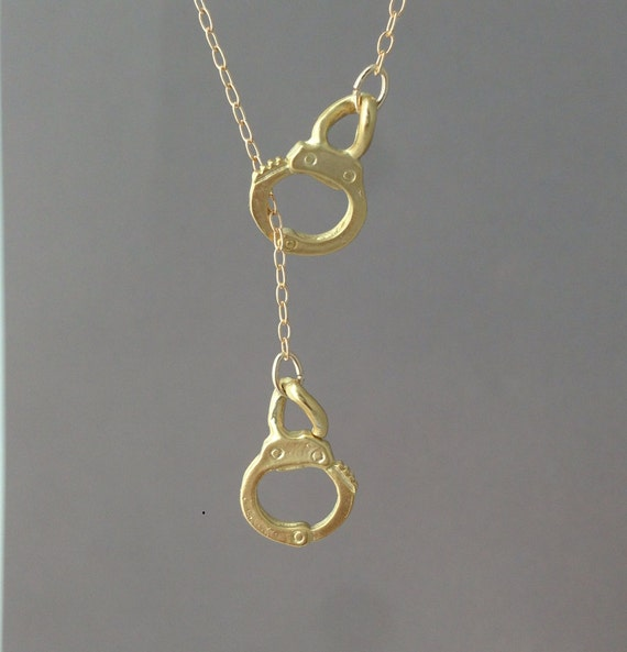 handcuff lariat necklace available in gold or silver