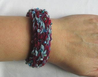 knit bangle in purple and teal with teal, blue, green beads