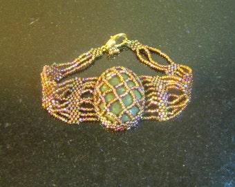 Green Jasper in a glass copper cage bracelet