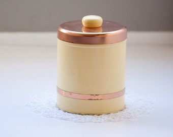 Yellow and Copper Storage Tin
