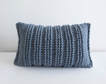 Blue knitted pillow