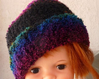 Rainbow hat smaller size number 1 hand knitted with boucle rainbow yarn