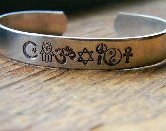 coexist bracelet made of  islam symbol, hamsa, om, david, peace, yin yang, ankh or christian cross, gender
