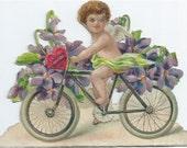 Victorian Die Cut Embossed Valentine Cupid on Bicycle 1930s Vintage