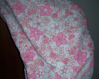 A hand made saddle cover, pink flowers, horse sadle cover, fully lined