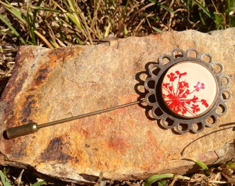 vintage style antiqued bronzed brooch with pressed red flowers and glass cabochon on beige leather