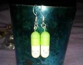 light green happy pill earrings