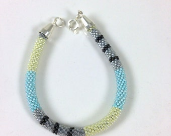 Azure (sky-blue), Light Yellow, Light Grey and Matte Grey Crochet Bracelet