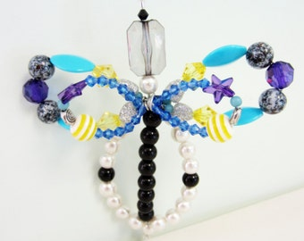 beaded screen door saver bug yellow black purple and turquoise beetle dragonfly butterfly suncatcher