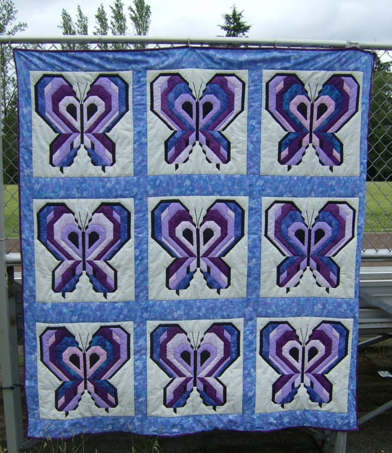 a beautiful purple butterfly quilt for a twin bed by LanethsQuilts