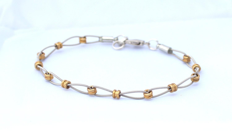 gold guitar string bracelet. Black Bedroom Furniture Sets. Home Design Ideas