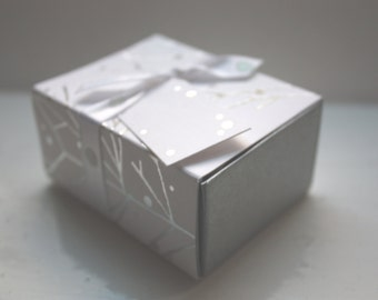 White gift box matchbox style with silver branches and ribbon,