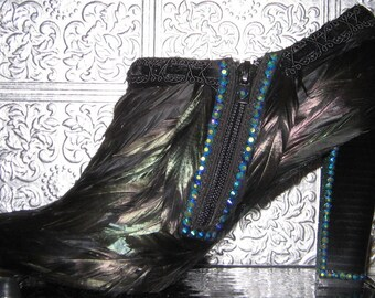 ankle boots with heels covereed with  black feathers, rhinestones ,and glitter