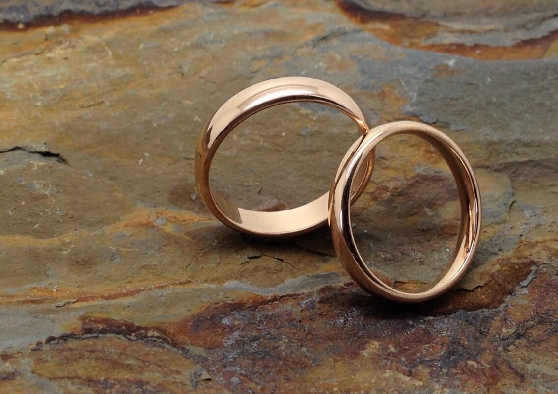 Eheringe rotgold am finger  Einfach elegant 18 k rose Gold passend schlicht Eheringe