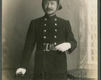 England Elland firefighter in uniform helmet antique cabinet photo