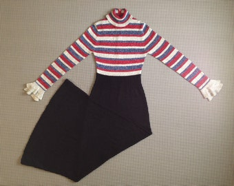1970's, turtleneck, maxi dress, with ruffle cuffs, in black, and sparkly silver, red and blue