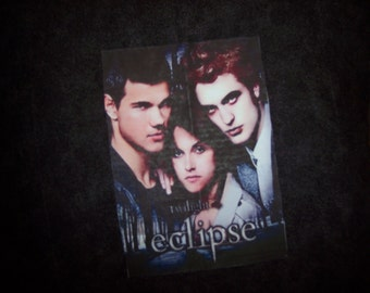 Hand-madeTwilight Eclipse throw pillow has Edward, Bella,Jacob. Back is solid black.