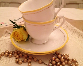 Vintage Royal Albert countess shaped tea cup and saucer in delicate White and Yellow fine bone china, 1920s.