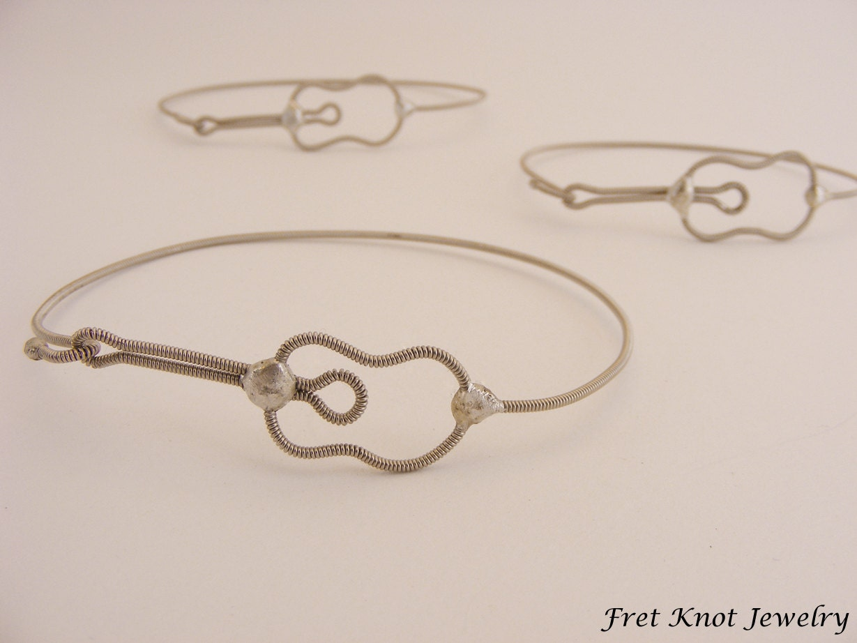 acoustic guitar bracelet jewelry made out of recycled guitar. Black Bedroom Furniture Sets. Home Design Ideas