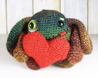Floppy-Ear Monster in Greens and Oranges with Big Red Heart