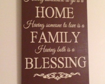 Having somewhere to go is a home, to love is a family, both is a blessing wood sign