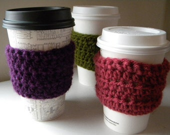 Crochet reusable coffee cozy.