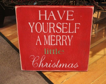 Lovely Christmas sign with Have yourself a merry little Christmas stenciled with white lettering. Background in red, distressed.