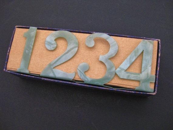 Vintage plastic freestanding numbers, 1-4