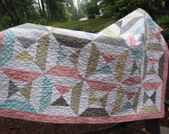Gray, pink, blue, and yellow baby quilt